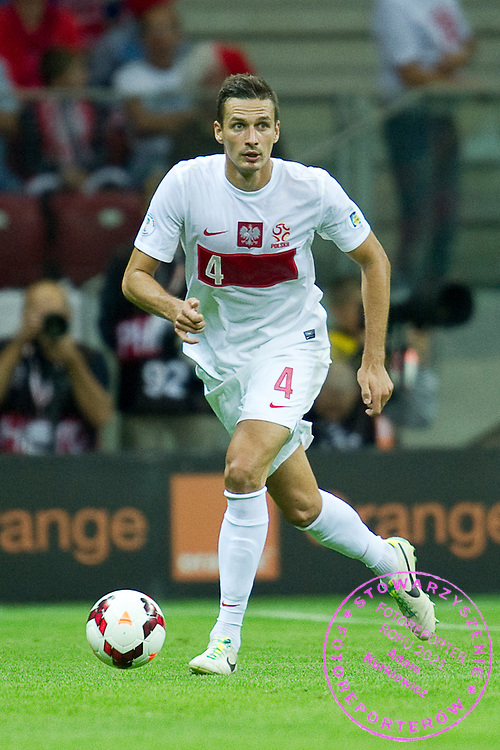 Poland's Lukasz Szukala controls the ball during the 2014 World Cup Qualifying Group H football match between Poland and Montenegro at National Stadium in Warsaw on September 06, 2013.<br /> <br /> Poland, Warsaw, September 06, 2013<br /> <br /> Picture also available in RAW (NEF) or TIFF format on special request.<br /> <br /> For editorial use only. Any commercial or promotional use requires permission.<br /> <br /> Mandatory credit:<br /> Photo by &copy; Adam Nurkiewicz / Mediasport