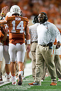 AUSTIN, TX - AUGUST 30:  Texas Longhorns head coach Charlie Strong congratulates quarterback David Ash #14 after throwing a touchdown against the North Texas Mean Green during the 3rd quarter on August 30, 2014 at Darrell K Royal-Texas Memorial Stadium in Austin, Texas.  (Photo by Cooper Neill/Getty Images) *** Local Caption *** David Ash; Charlie Strong