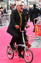 Alan Yentob  arriving on his  foldaway bike for the Miss Saigon 25th anniversary press night at the Prince Edward Theatre in London, Wednesday, 21st May 2014. Picture by Stephen Lock / i-Images