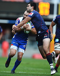 Cape Town-180427 Dewaldt Duvenage  of Stomers tackled by Adam Coleman  of the Rebels in a Super 15 match played at Newlands stadium.photograph:Phando Jikelo/African News Agency/ANA