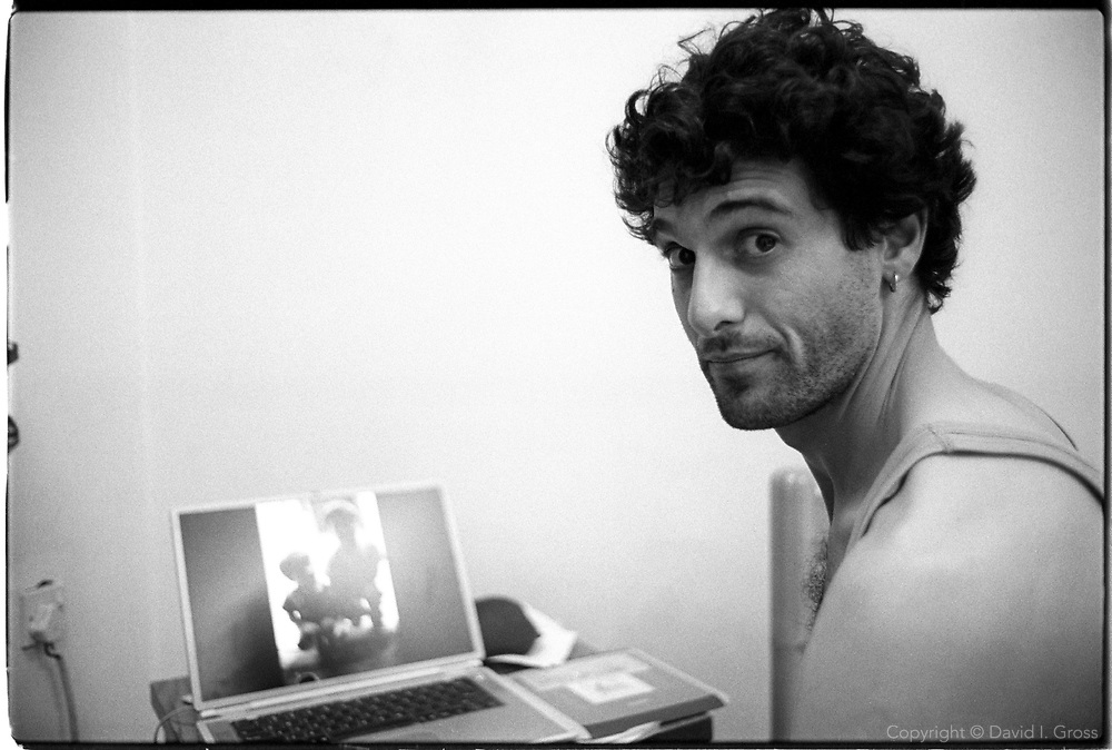 David Gross in his hotel room in Baghdad, Iraq, editing pictures from a day's shooting.
