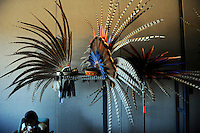 "Headdresses ready before a performance on September 9th, 2012 at Fiesta del Mar at the Monterey Bay Aquarium. By teaching their children traditional dances and conduct, members of the Yaocuauhtli - Eagle Warrior ""calpulli,"" or group, are preserving a proud ethnic heritage."