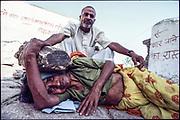 Crushing evil spirits out of a possessed woman, Balaji Temple, Rajasthan. Newsweek Magazine.