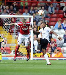 Bristol City's Aden Flint battles for the high ball with Peterborough United's Britt Assombalonga  - Photo mandatory by-line: Joe Meredith/JMP - Tel: Mobile: 07966 386802 14/09/2013 - SPORT - FOOTBALL -  Ashton Gate - Bristol - Bristol City V Peterborough United - Sky Bet League One
