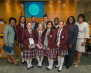 Houston ISD trustee Paula Harris poses for a photograph with members of the Young Women's College Preparatory Academy and Leland Young Men's College Preparatory Academy robotics teams pose for a photograph during a Board meeting, April 9, 2015.