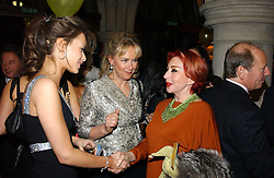 Left to right, MISS CAMILLA AL FAYED, her mother MRS MOHAMED AL FAYED and MRS PANAGIOTIS LEMOS at The Magic of Winter ball in aid of the charity KIDS held at The Royal Courts of Justice, London on 2nd Ferbruary 2005.<br />