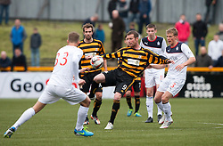 Alloa Athletic's Andy Kirk and Falkirk's Stephen Kingsley.<br /> Alloa Athletic 0 v 0 Falkirk, Scottish Championship 12/10/2013. played at Recreation Park, Alloa.<br /> &copy;Michael Schofield.