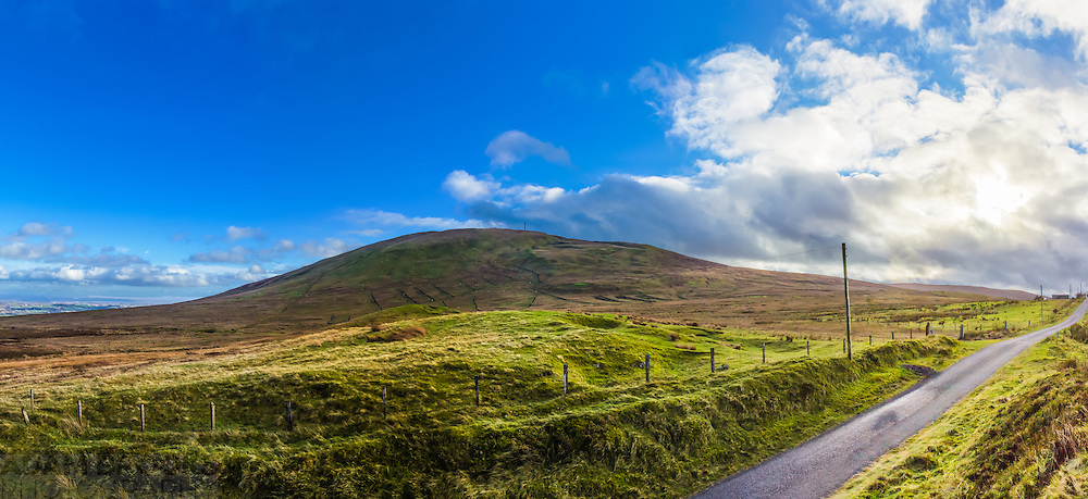 On the advice of a good friend and fellow photography addict, I've decided to also offer this picture with a much restricted field of view showing only Slieve Gallion and the road onwards towards the bright sun.<br />