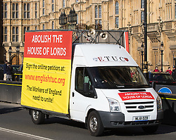 Westminster, London, March 7th 2017. A mobile billboard van from the English Trades Union Congress (ECTU) drives past the Palace of Westminster, calling for the abolition of the House of Lords.