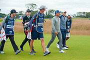 Rickie Fowler (USA)(centre), Robert MacIntyre (SCO)(left) and Rory McIlroy (NIR) head off down the fairway after hitting their opening tee shots during the second round of the Aberdeen Standard Investments Scottish Open at The Renaissance Club, North Berwick, Scotland on 12 July 2019.
