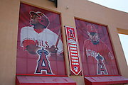 ANAHEIM, CA - APRIL 26:  Murals of Vladimir Guerrero #27 and Manager Mike Scioscia #14 of the Los Angeles Angels of Anaheim flank a banner noting the seven years that the Angels were American League West Champions during the game against the Seattle Mariners at Angel Stadium on Sunday, April 26, 2009 in Anaheim, California.  The Angels shut out the Mariners 8-0.  (Photo by Paul Spinelli/MLB Photos via Getty Images) *** Local Caption *** Vladimir Guerrero;Mike Scioscia