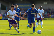 AFC Wimbledon midfielder Callum Reilly (33) battles for possession during the EFL Sky Bet League 1 match between AFC Wimbledon and Shrewsbury Town at the Cherry Red Records Stadium, Kingston, England on 14 September 2019.