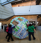 """Members of Girl Scout Troop 9448 carry a part of their piece """"Space Invaders Take Dallas"""" to the Cookie Box Creations design contest presented by the Girl Scouts of Northeast Texas at the Perot Museum of Nature & Science on Sunday, February 17, 2013 in Dallas, Texas. (Cooper Neill/The Dallas Morning News)"""