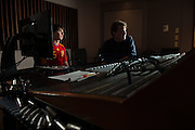 Audio production student Leo Sideras (Left) assists Eddie Ashworth in a recording session at MDIA Sound.