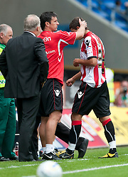 CARDIFF, WALES - Sunday, August 8, 2010: Sheffield United's Matthew Lowton is consoled by coach Gary Speed after being shown the red card during the League Championship match against Cardiff City at the Cardiff City Stadium. (Pic by: David Rawcliffe/Propaganda)