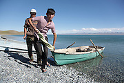 Fishermen come ashore on the northeast side of lake Song Köl, Kyrgyzstan