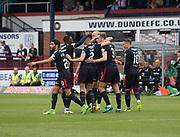 27th August 2017, Dens Park, Dundee, Dundee; Scottish Premier League football, Dundee versus Hibernian; Dundee's Kevin Holt is congratulated after scoring