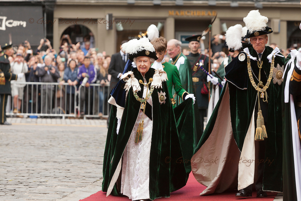 The Queen and the Duke of Edinburgh arrive at St. Giles Cathedral, Edinburgh.<br /> Prince William and the Princess Royal were also in attendance at a ceremony to award the Order of the Thistle to Lord Smith of Kelvin and the Earl of Home. Edinburgh, Scotland, UK. 3rd July 2014