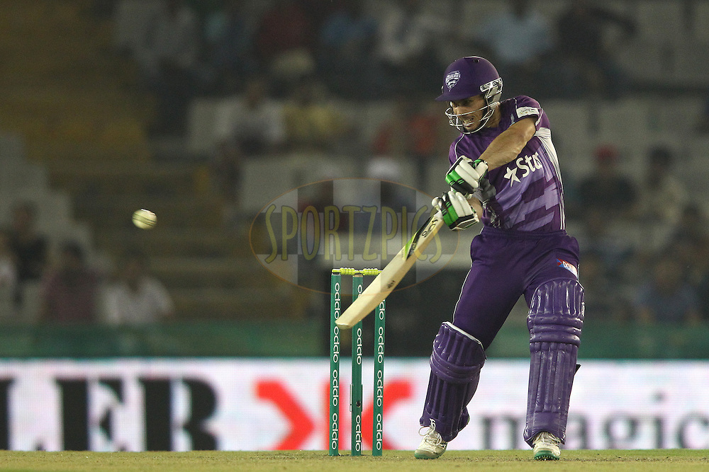 Jon Wells of the Hobart Hurricanes square cuts a delivery towards the third man boundary during match 2 of the Oppo Champions League Twenty20 between the Kings XI Punjab and the Hobart Hurricanes held at the Punjab Cricket Association Stadium, Mohali, India on the 18th September 2014<br /> <br /> Photo by:  Shaun Roy / Sportzpics/ CLT20<br /> <br /> <br /> Image use is subject to the terms and conditions as laid out by the BCCI/ CLT20.  The terms and conditions can be downloaded here:<br /> <br /> http://sportzpics.photoshelter.com/gallery/CLT20-Image-Terms-and-Conditions-2014/G0000IfNJn535VPU/C0000QhhKadWcjYs