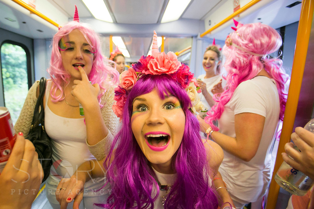 """UNITED KINGDOM, London: 16 May 2015 Rugby fans travel to Twickenham on the train for the Marriott London Sevens Rugby tournament. More than 113,000 fans, most of them in fancy dress, will ascend onto Twickenham for the sporting entertainment. This years fancy dress theme was """"Space"""". Rick Findler / Story Picture Agency"""