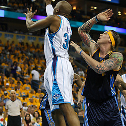 25 April 2009: New Orleans Hornets forward David West (30) shoots past Denver Nuggets center Chris Andersen (11) during a NBA Western Conference quarter-finals playoff game between the New Orleans Hornets and the Denver Nuggets at the New Orleans Arena in New Orleans, Louisiana.