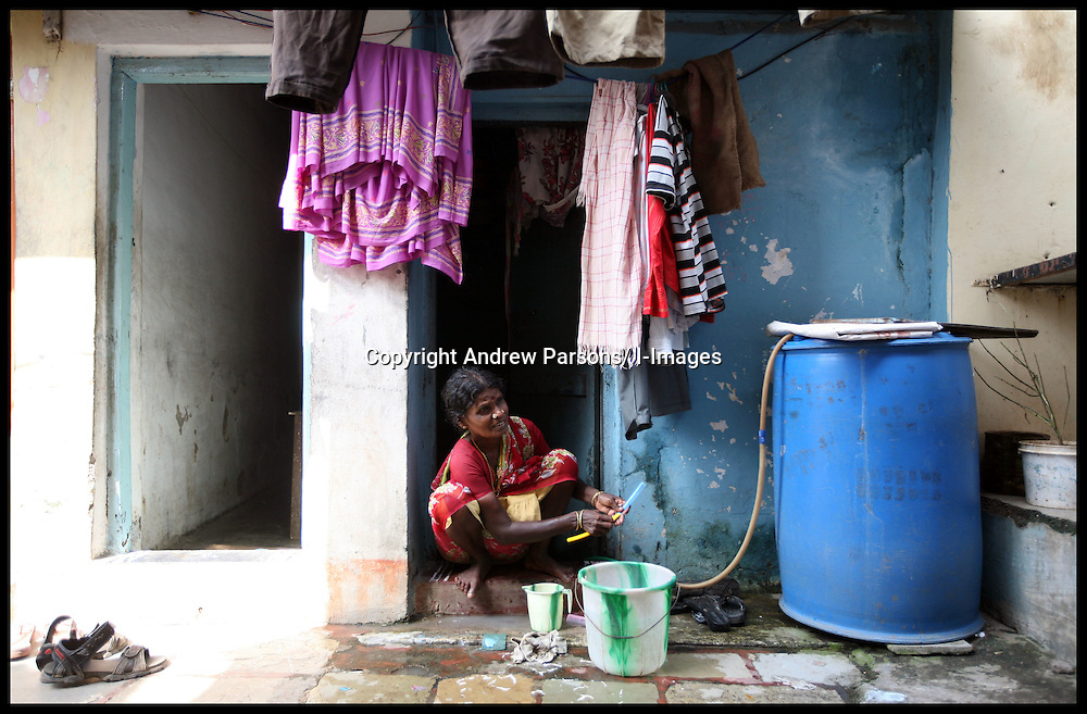 An indian woman washing her clothes in Dharavi Slum in Mumbai is one of the largest slums in the world, it is where Slumdog Millionaire was filmed. Photo by Andrew Parsons/  i-images