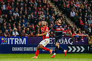 Charlton Athletic forward Lyle Taylor (9) and Doncaster Rovers defender Danny Andrew (3) track a high ball during the EFL Sky Bet League 1 second leg Play-Off match between Charlton Athletic and Doncaster Rovers at The Valley, London, England on 17 May 2019.