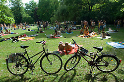 Summer crowds relaxing in The English Garden in Munich Germany