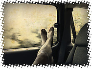 feet up on car window while traveling cellphone photography,Iphone pictures,smartphone pictures
