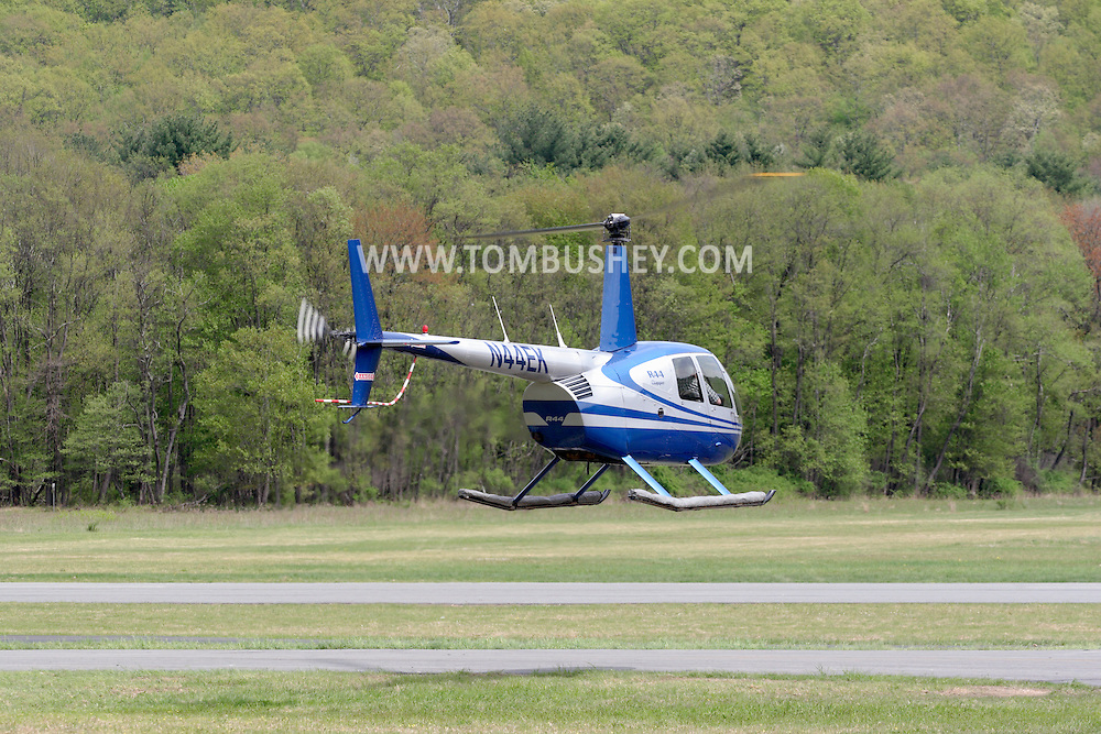 Wurtsboro, NY - A Robinson R44 helicopter takes off from Wurtsboro Airport on May 11, 2008.
