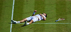 04.07.2014, All England Lawn Tennis Club, London, ENG, ATP Tour, Wimbledon, im Bild Grigor Dimitrov (BUL) lies prone after falling and losing a point during the Gentlemen's Singles Semi-Final match on day eleven // during the Wimbledon Championships at the All England Lawn Tennis Club in London, Great Britain on 2014/07/04. EXPA Pictures © 2014, PhotoCredit: EXPA/ Propagandaphoto/ David Rawcliffe<br /> <br /> *****ATTENTION - OUT of ENG, GBR*****