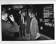 Henry Kissinger posing for photographs with members of the publicafter leaving Fete De Famille in New York 1990,ONE TIME USE ONLY - DO NOT ARCHIVE  © Copyright Photograph by Dafydd Jones 66 Stockwell Park Rd. London SW9 0DA Tel 020 7733 0108 www.dafjones.com