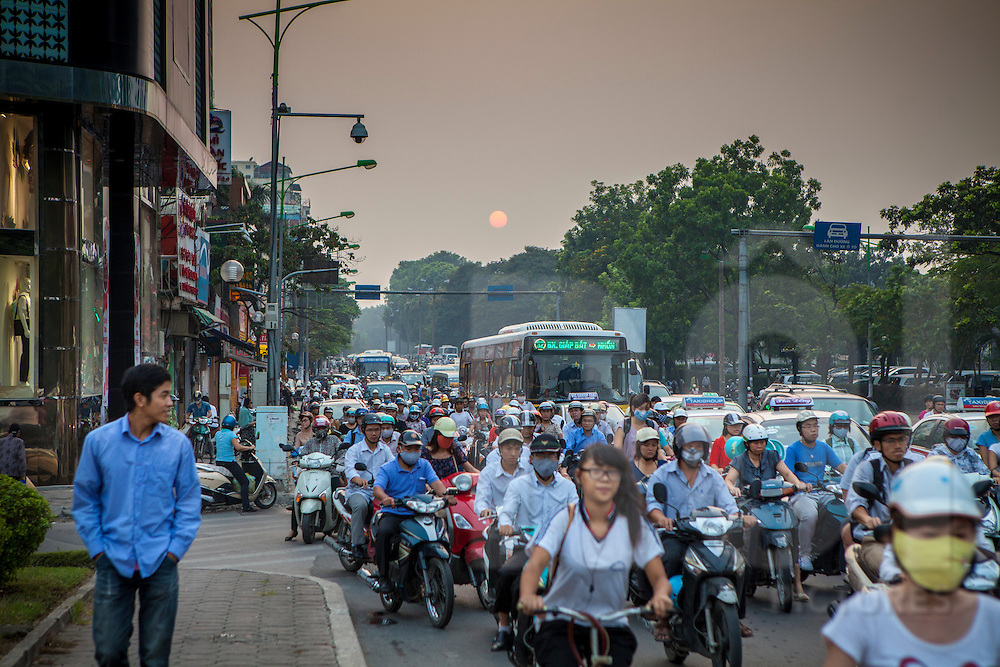 Commuter traffic along Kim Ma street, Hanoi, Vietnam, Southeast Asia
