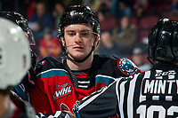 KELOWNA, BC - DECEMBER 18: Jake Lee #21 of the Kelowna Rockets stands between ice officials after a dust up with the Vancouver Giants at Prospera Place on December 18, 2019 in Kelowna, Canada. (Photo by Marissa Baecker/Shoot the Breeze)