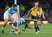 Twickenham. Great Britain,  Will GENIA, tackled by Tomus LAVANINI, during, Semi Final. Australia vs Argentina  2015 Rugby World Cup,  Venue, Twickenham Stadium, Surrey England.   Sunday  25/10/2015   [Mandatory Credit; Peter Spurrier/Intersport-images]
