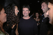 Terri Seymour and Simon Cowell. Marks and Spencer celebrate the launch of the new men's Autograph collection. Fifty Below. 50 St. James's St. London. SW1. 7 September 2005. ONE TIME USE ONLY - DO NOT ARCHIVE  © Copyright Photograph by Dafydd Jones 66 Stockwell Park Rd. London SW9 0DA Tel 020 7733 0108 www.dafjones.com