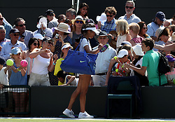 Su-Wei Hsieh signs autographs for fans after her win against Simona Halep on day six of the Wimbledon Championships at the All England Lawn Tennis and Croquet Club, Wimbledon. PRESS ASSOCIATION Photo. Picture date: Saturday July 7, 2018. See PA story TENNIS Wimbledon. Photo credit should read: Jonathan Brady/PA Wire. RESTRICTIONS: Editorial use only. No commercial use without prior written consent of the AELTC. Still image use only - no moving images to emulate broadcast. No superimposing or removal of sponsor/ad logos. Call +44 (0)1158 447447 for further information.