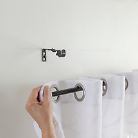 How to hang curtains: hanging grommet-top curtain on curtain rod
