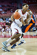 FAYETTEVILLE, AR - DECEMBER 19:  Coty Clarke #4 of the Arkansas Razorbacks drives to the basket against the UT Martin Skyhawks at Bud Walton Arena on December 19, 2013 in Fayetteville, Arkansas.  The Razorbacks defeated the Skyhawks 102-56.  (Photo by Wesley Hitt/Getty Images) *** Local Caption *** Coty Clarke