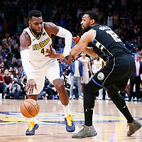01 April 2018: Denver Nuggets forward Paul Millsap (4) drives past Milwaukee Bucks forward Jabari Parker (12) during the Denver Nuggets 128-125 victory over the Milwaukee Bucks, at the Pepsi Center, Denver, Colorado, USA.