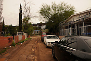 Razor wire surrounds residential properties located near the Mexican border wall in Nogales, Arizona, USA.