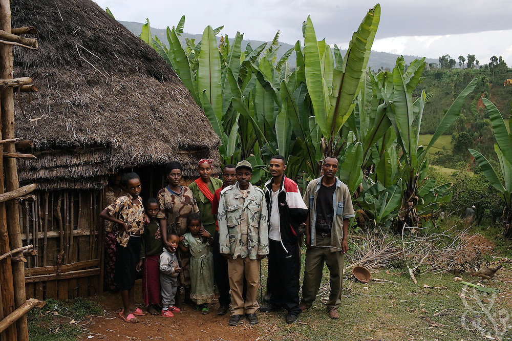 Coffee farmer Yumura Yune (age 36, in camouflage jacket) stands with his wife and children February 23, 2007 outside his home in the Sidamo coffee region of southern Ethiopia in the village of Bokaso. Yune struggles to make enough money through coffee farming and says that coffee prices earned by Ethiopian farmers need to increase in order for him to get ahead.