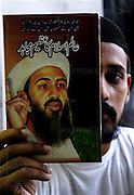 "A man holds up a book on Osama Bin Laden called ""A Great Leader of the World of Islam"" in Peshawar, Pakistan on Monday Aug. 7, 2006. It is being sold in the old bazar of Peshawar."