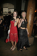 Alina Fedynshaynets and Olena Portsh. Cartier Polo Players Party, The Collection, 264 Brompton Road, London, SW3, 25 July 2006. ONE TIME USE ONLY - DO NOT ARCHIVE  © Copyright Photograph by Dafydd Jones 66 Stockwell Park Rd. London SW9 0DA Tel 020 7733 0108 www.dafjones.com
