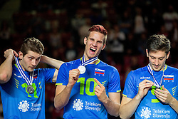 Danijel Koncilja #11 of Slovenia, Jan Kozamernik #10 of Slovenia and Dejan Vincic #9 of Slovenia celebrate at trophy ceremony after placed 2nd after volleyball match between National teams of Slovenia and France at Final match of 2015 CEV Volleyball European Championship - Men, on October 18, 2015 in Arena Armeec, Sofia, Bulgaria. Photo by Vid Ponikvar / Sportida