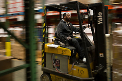 God's Pantry City Dock Coordinator William Johnson moves a shipment of goods to the loading area, Thursday, April 13, 2017 at God's Pantry Food Bank in Lexington.