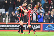 Ryan Fraser (24) of AFC Bournemouth celebrates the 2-1 win at full time with Simon Francis (2) of AFC Bournemouth  during the Premier League match between Bournemouth and Everton at the Vitality Stadium, Bournemouth, England on 30 December 2017. Photo by Graham Hunt.