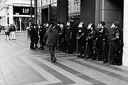 Seattle Police line up in front of businesses near the Freedom Rally at Westlake Park. Seattle, WA. August 13, 2017.