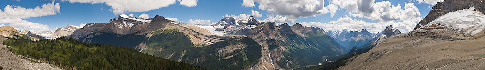 A panorama of Yoho Valley (with Waputik Icefield, Daily Glacier, and Takakkaw Falls) unfolds from the Iceline Trail, in Yoho National Park, British Columbia, Canada. Yoho is part of the Canadian Rocky Mountain Parks World Heritage Site declared by UNESCO in 1984. Panorama stitched from 16 images.