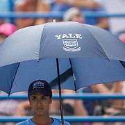 August 21, 2014, New Haven, CT:<br /> A Yale umbrella is held over players on Stadium Court during a match on day seven of the 2014 Connecticut Open at the Yale University Tennis Center in New Haven, Connecticut Thursday, August 21, 2014.<br /> (Photo by Billie Weiss/Connecticut Open)